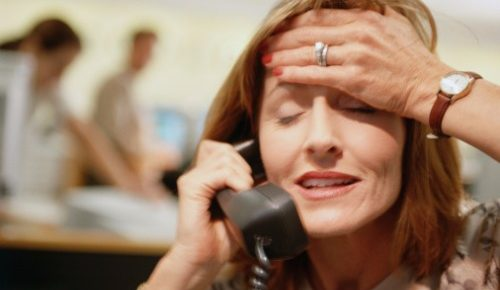 businesswoman-on-telephone-picture-id477859103-500x290