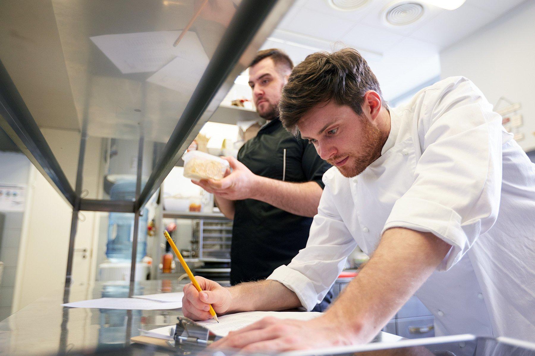 Kitchen staff working on their assigned tasks